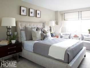 Master bedroom in shades of gray and white with a South African shell sculpture