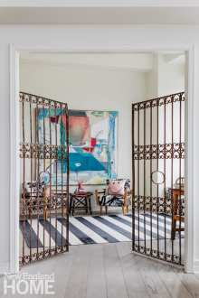 antique French gates separate the office