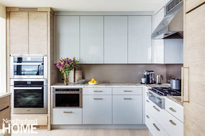 bright kitchen with modern touches like a leather-finished marble countertop and zinc backsplash