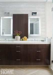 Bathroom with dark wood, double-sink vanity. There are separate mirrors hanging above each sink. The countertops are white.