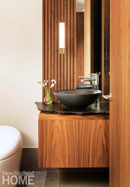 Powder room with walnut vanity, black bowl sink and white toilet