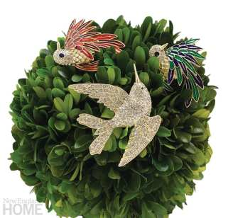 A wreath adorned with three crystal and enamel birds