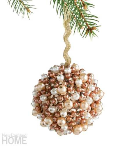 Ball Christmas ornament studded with white and champagne-colored pearls