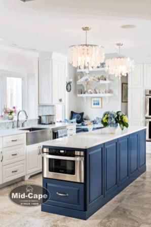 Mid-Cape Home Centers Kitchen with blue and white cabinets, stainless steel appliances and a stainless steel farmhouse sink