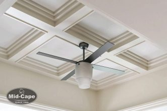 Mid-Cape Home Centers A ceiling shot with white beams and a ceiling fan