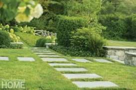 square stepping stones in the green grass