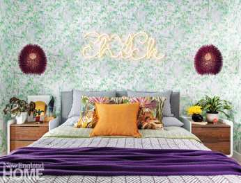Guest bedroom with neon sign reading chic chick above the bed