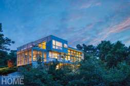 Architects Don DiRocco and Mark Hammer tucked three levels into the side of a steep hill. Landscape architect Jessalyn Jarest planted red pines and tupelo trees to screen the house from neighbors below.