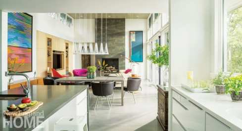 High and low styles—a dining table from Roche Bobois, cabinetry from IKEA—coexist happily in the open kitchen/dining area.