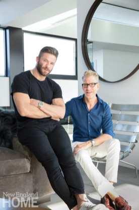 Julian Edelman dressed in black and standing next to designer Duncan Hughes.