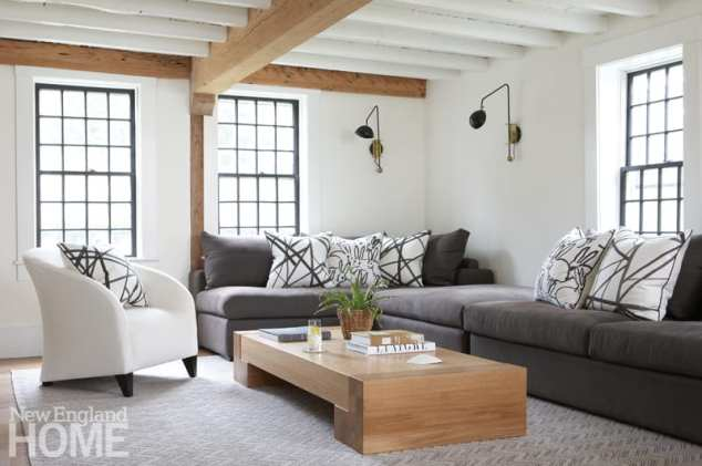Family room with gray couches and black and white pillows
