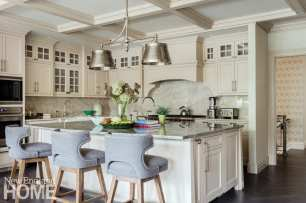 Kitchen with an island surrounded by barstools.