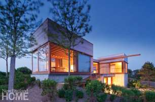 Exterior of a modern home lit up at night