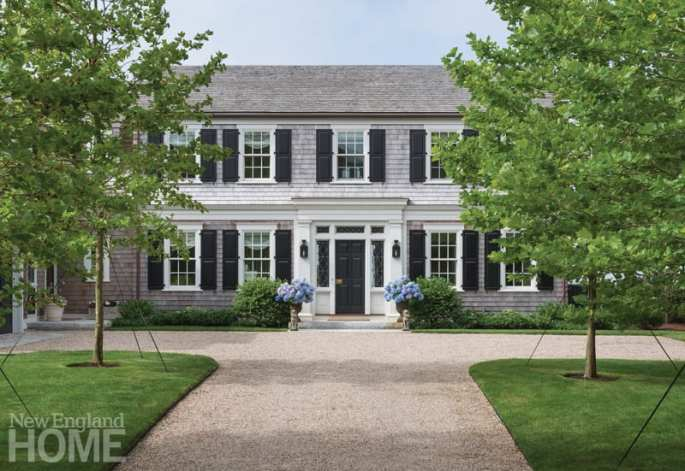 Front of house with hydrangeas on the steps