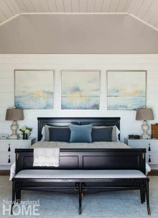 Master bedroom with dark wood bed and a dark wood bench at the foot of the bed