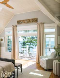 Master bedroom looking out french doors onto a deck with views of the ocean