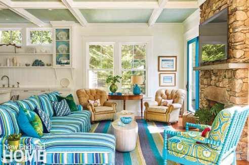 living area with blue and green striped sofa and rug