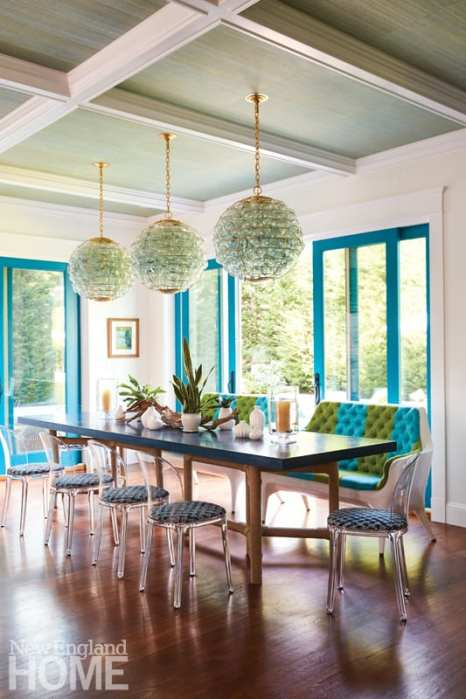 dining area with blue-framed sliding glass doors leading outside