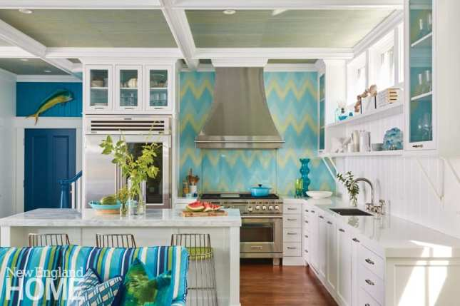 kitchen with white cabinets and a blue and green backsplash