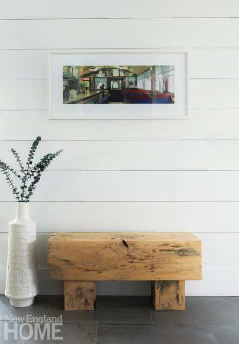 Above the foyer's welcoming bench hangs a prized photograph by a favorite artist—Caitlin Stone, the homeowners' daughter.