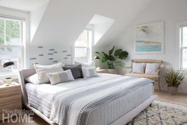 Light from the dormers spills into the comfortable new master bedroom in the second-floor addition.