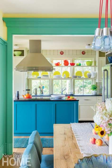 From the dining room, looking into the kitchen with its blue cabinets