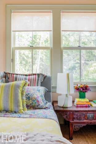 master bedroom with tall trees outside the window