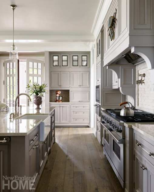 The kitchen was designed with two islands: one for the couple to share with every party's ubiquitous crowd in the kitchen and another for the caterer.