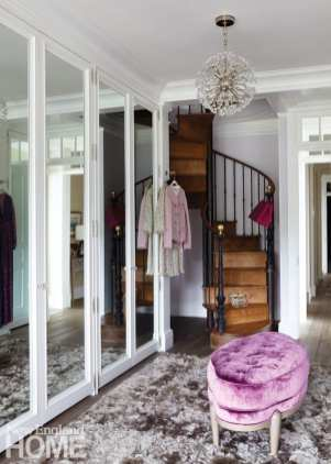 The spiral staircase in the wife's dressing room leads to an extension of her closet.