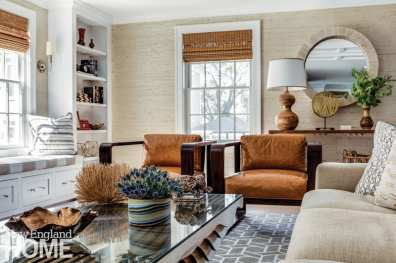 A Newport vacation home's living room with leather side chairs