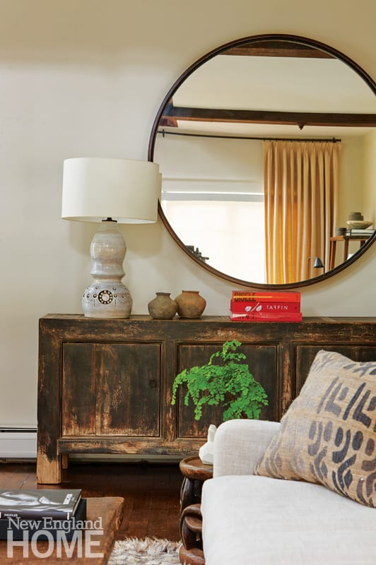 detail of sideboard with lamp and mirror from bungalow of westport
