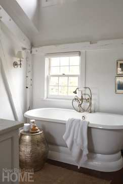 The master bathroom features Josef Albers lithographs, Turkish bath sheets, and a silver stool from Morocco.