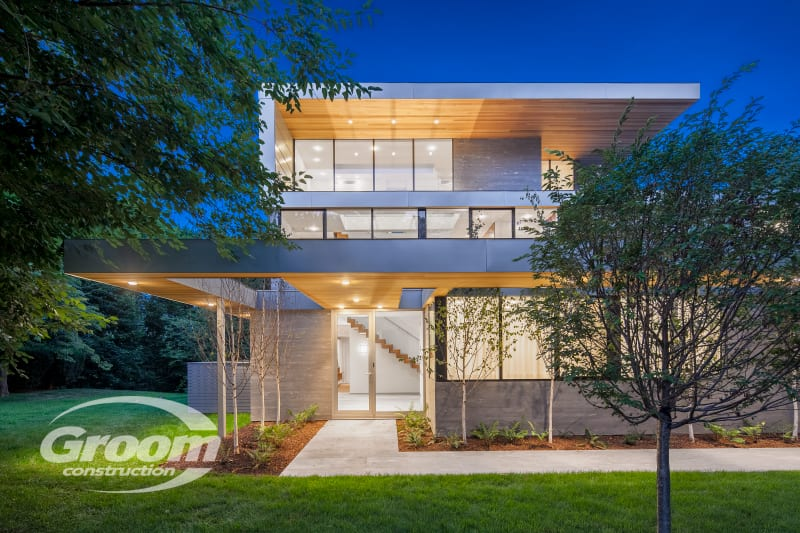 cost to build a contemporary home exterior lit up a night