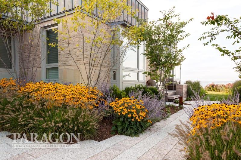 year-round backyard entertaining yellow flowers