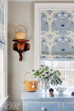 Nantucket-style vignette on blue dresser