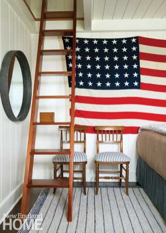 A ladder leads to a loft that provides space for play in the otherwise cozy confines of the upstairs bedroom of the family's twin boys.