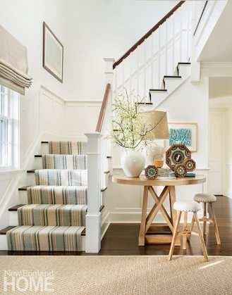 Four sailors' valentines decorate the nook by the stairway that leads to the family's bedrooms.