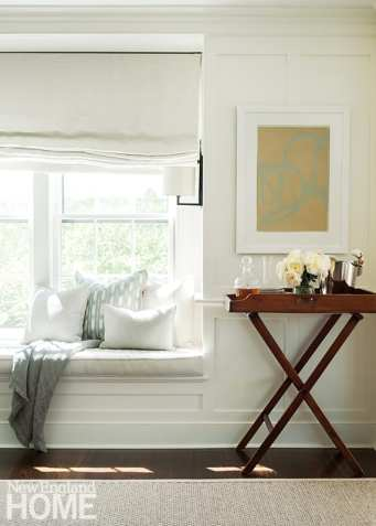 A window seat in the dining room offers a casual perch for reading as well as a place to prop locally crafted pillows from Nantucket Looms.