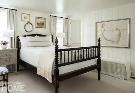 A charming first-floor guestroom features a classic four-post bed.