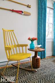 Yellow rocking chair by Kartell