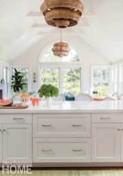 White kitchen with natural fiber pendant