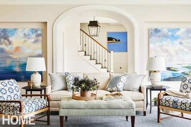 Living room with white couch and artwork