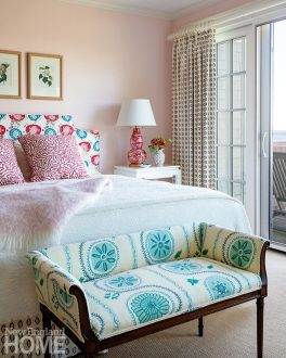 This guestroom was frequented by Skok's mom when she was still able to visit from South Africa; that's the designer's own fabrics on the headboard, curtains, and bench.