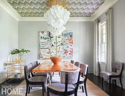 Contemporary dining room with modern art and wallpapered ceiling