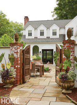Outdoor patio Southport, Connecticut with large wooden gate