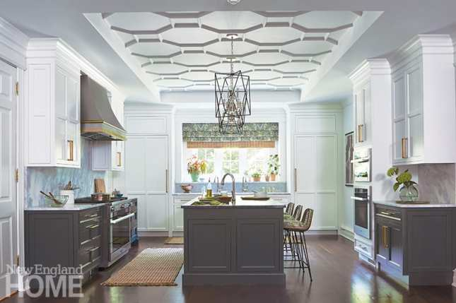 In addition to white-painted cabinetry, which replaced a set of dark mahogany cabinets, a glass backsplash under the kitchen's lone window enhances the natural light.