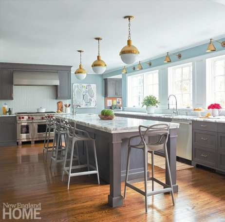 Traditional kitchen with wooden floors and gray cabinetry.