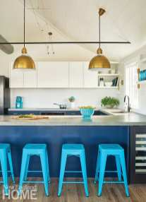 """Crestin painted the lower kitchen cabinets Benjamin Moore's Polo Blue, a favorite hue she also used on the pegboard in the mudroom. """"Repetition is your friend in a small space,"""" she says."""