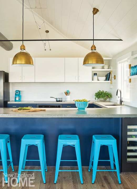 "Crestin painted the lower kitchen cabinets Benjamin Moore's Polo Blue, a favorite hue she also used on the pegboard in the mudroom. ""Repetition is your friend in a small space,"" she says."