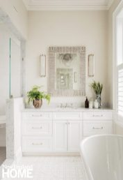His-and-hers vanities each get the same Malena mirror from Made Goods to give the main bath symmetrical style.